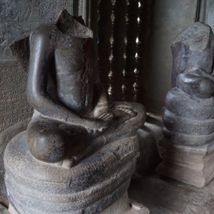 headless statue due to looting