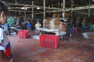 taking the rice paper off the drying mats