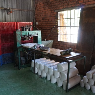 cutting machine, and rolls of circular rice paper ready to be bagged