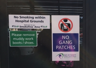 Entrance signage. No gang patches, and remove muddy shoes...and enter shoeless.